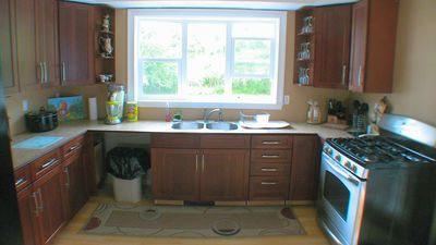 Modern kitchen with gas oven and plenty of storage.