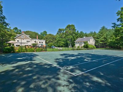 Professional Har-Tru tennis court.  Large area for soccer, croquet, volley ball