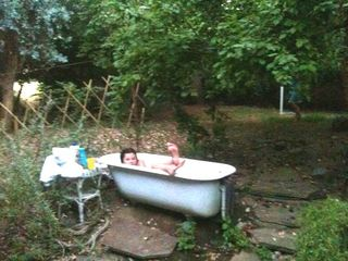 Three Rivers farmhouse photo - fun in the outdoor bathtub
