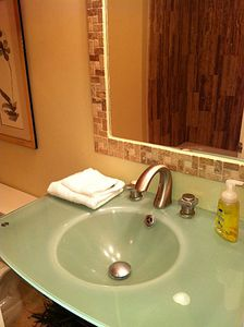 Decolav sinks & cross-cut marble shower... rejuvenate in spa-inspired baths UL.