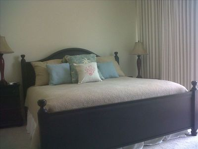 Guest bedroom w/ king size bed, flat screen tv, and private bath