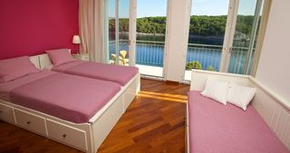 Milna villa photo - Second bedroom with seafront balcony