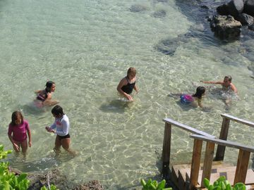 Kids love to swim in the sandy bathtub area protected from surf
