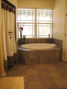 Master bathtub & master shower shown