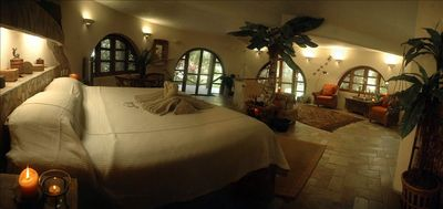 Romantic bedroom in one of five guest houses on the property.