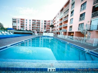 Swimming pool and view of condominium