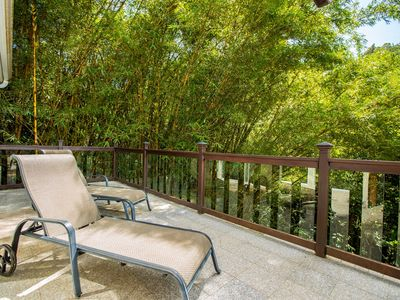 Large spacious granite deck w patio chairs. Relax in paradise!