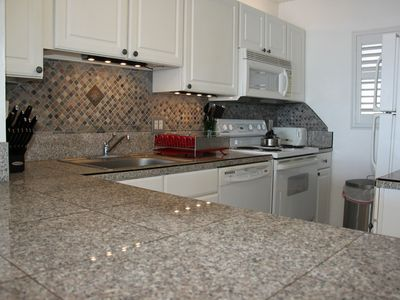 granite countertop, full refrigerator, full oven, , coffee maker, dish washer