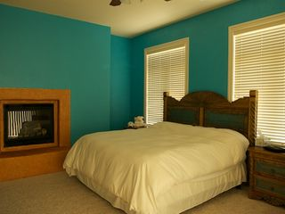 Ruidoso condo photo - master bedroom w/ gas fire place