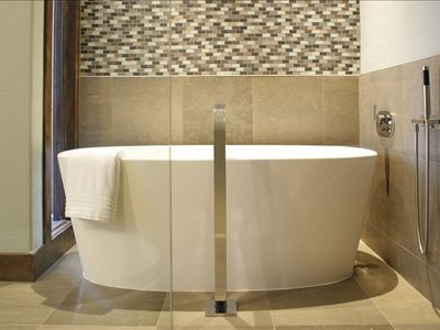 The Master Bath features a deep soaking tub