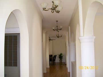 Spacious first floor corridor with partial view of dinning room at the end