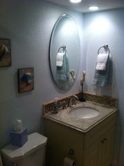 Smaller downstairs full hallway bath - Indian Shores condo vacation rental photo