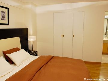 The bedroom has many lighting options from ceiling lights that dim to side light