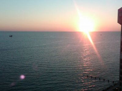 Sunset view from our 15th floor large balcony overlooking the Gulf.
