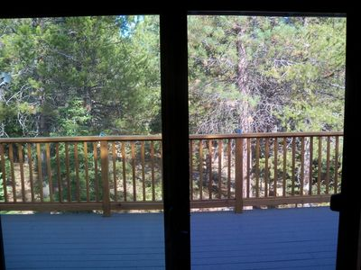View from the Dining Area to the Back Deck and Green Space