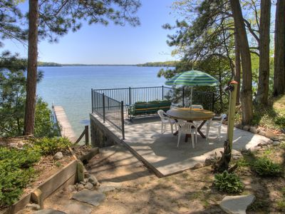 Traverse City cabin rental - Deck above the boat house seen from Tall Pines cabin