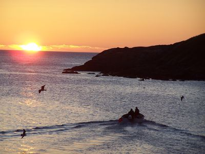 Fisherman leaving at dawn from Tors Cove