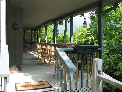 Rock away the day while bird watching on the covered porch.