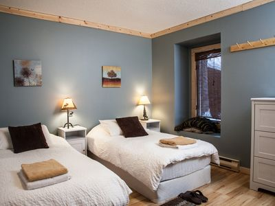 Revelstoke chalet rental - Bedroom on main floor, Beds can be pushed together to make a king bed for couple