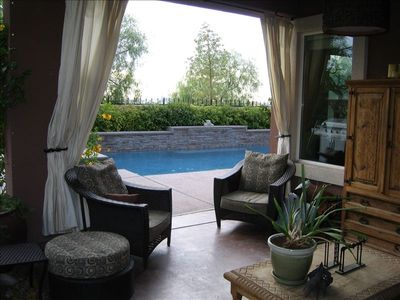 Covered rear patio. Additional patio in private enclosed entry courtyard