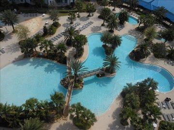 Palms of Destin condo rental - View of the awesome pool area with palm trees galore!!