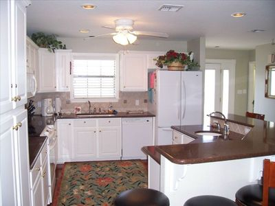 Rockport house rental - Open concept kitchen with breakfast bar that seats 6. Great for entertaining!