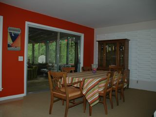 Fennville house photo - Open dining room, which walks out to screened porch and deck