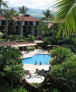 View of the pool and one hot tubs from our lanai
