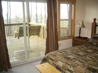 Beech Mountain house rental - Master bedroom 2 on game room level w/ deck access and 2 person swing