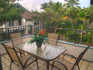 Poipu condo photo - The rear lanai overlooks the lush grounds and the swimming pool.