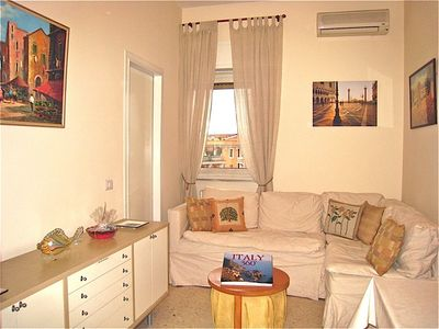 Trastevere area condo rental - The living/dining room is decorated in neutrals with a new comfortable sectional