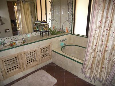 One of two beautiful tiled bathrooms