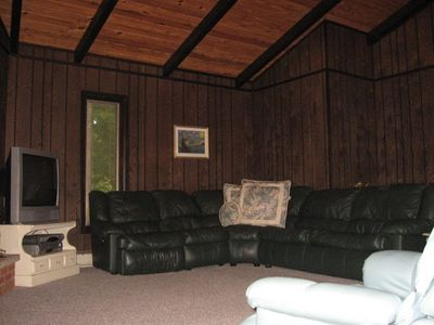 Living room w/ fireplace (wood provided) and DVD player