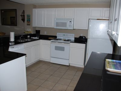 Spacious kitchen with ample counter space,storage and kitchen supplies.