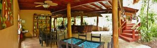Puerto Viejo bungalow photo - Main house for breakfast, bar services, shared kitchen, shared library and pool