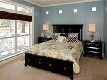 Master Bedroom: Ocean views, TV, huge private bathroom. Access to amazing porch.