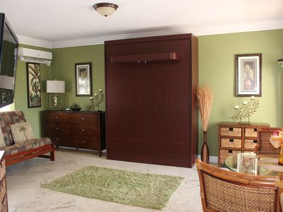 A queen size murphy bed, easily comes down. See next picture.