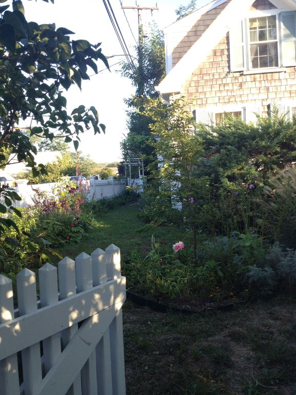 Fenced gated area isolating the front garden from the Town of Wellfleet.
