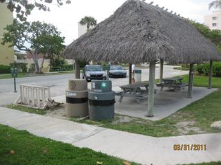 Deerfield Beach condo photo - View of Hut in front of condo building with seating and and adjacent showe