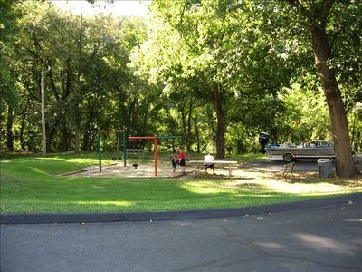 Waterfront playground area with picnic tables, grills, and a nature trail too!