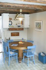 Port Clyde cottage photo - Eat-in kitchen is great for dining or games.