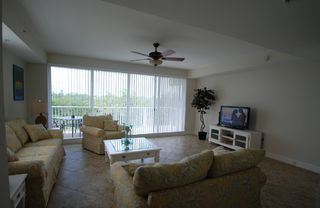Tampa townhome photo - Living room w.sofa group,1 queen sofa bed, 46 LCD-TV,DVD,CD,High speed wireless