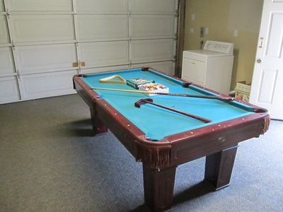 Detached garage has a pool table and air-hockey table.
