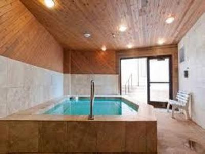 The hot tub has been newly renovated and is just steps away from the heated pool