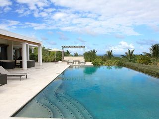 Orient Bay villa photo - View of house and pool