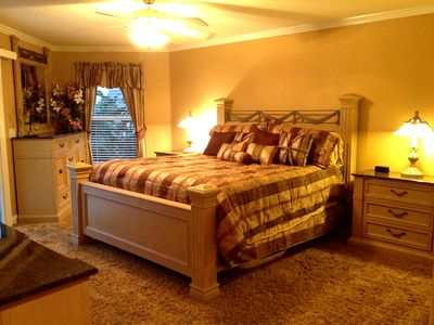 Master Bedroom-King size bed with balcony overlooking dock and pool, with access