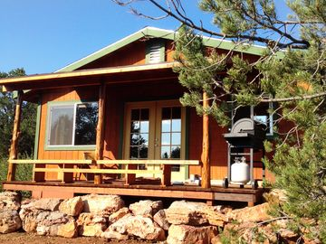 Ash Fork cabin rental - Front View of the cozy cabin. A nice covered patio to enjoy the fabulous views!