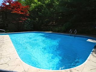 Woodstock house photo - Flagstone Deck around large pool