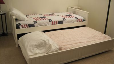 Trundle bed converts from day bed / couch to two twin beds.