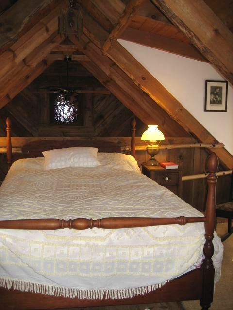 3 cozy upstairs bedrooms are furnished with antiques